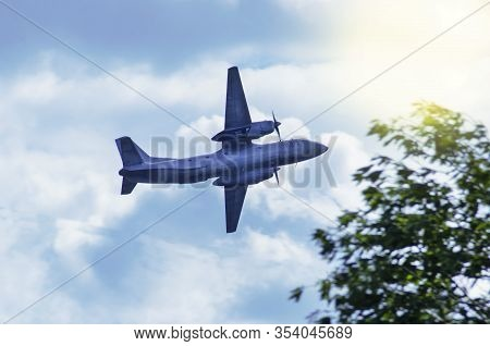 Airplane On A Background Of Blue Sky At Dawn With Copy Space. Flight, Take Off Up.