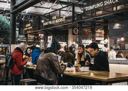 London, Uk - December 14, 2019: People At The Tables Inside Spitalfields Market, One Of The Finest V