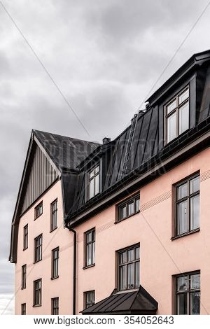 Pastel Colored Residential Building With Black Roof. Stockholm, Sweden.