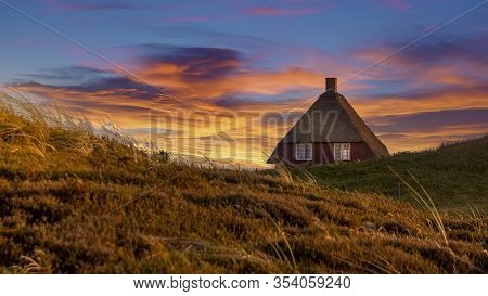 Nymindegab, Denmark - 07 Juli 2018: Small Red House On The Danish West Coast That Is Filled With Bea