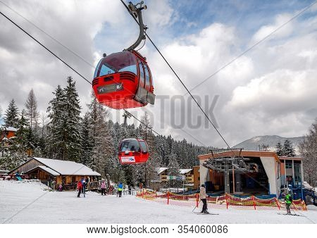 Ruzomberok, Slovakia - February 28: Cabin Of Cableway And Skiers On Slope At Resort Malino Brdo On F