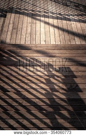 Staircase With A Shadow From The Railing. Close-up Staircase With Wooden Steps And A Shadow From The