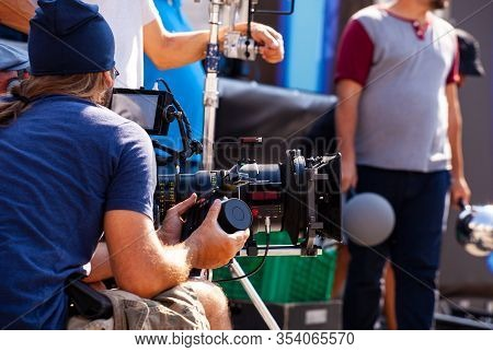 Focus Puller Hold The Wireless Follow Focus System During The Filming Process