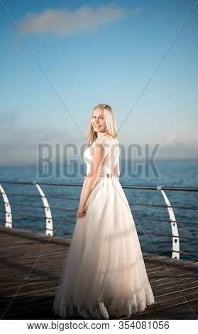Happy Bride In A Wedding Dress,wedding Outfit Bride,young Duffel Is Spinning In A Wedding Dress On A