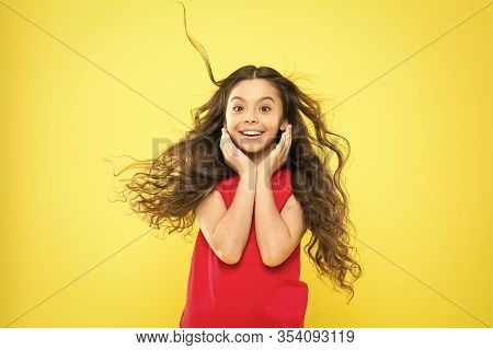 Things You Doing To Damage Your Hair. Girl Adorable Kid Long Wavy Hair Yellow Background. Wind Can A
