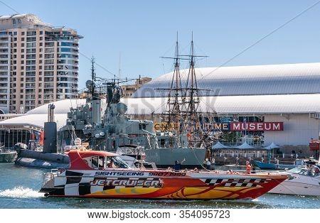 Sydney, Australia - December 11, 2009: Darling Harbour. High Velocity Jet Cruiser Passes Ships On Di