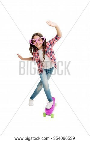 Lets Have Fun. Kid Having Fun With Penny Board. Child Smiling Face Stand Skateboard. Penny Board Cut