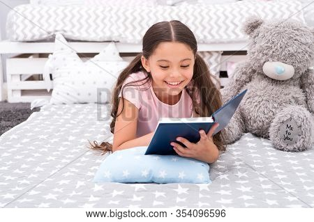 Home Schooling. Small Girl Read Book At Home. Enjoying Home Reading. Getting Home Education. Private