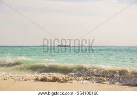 Amazing Beauty  Atlantic Ocean Turquoise Water Surface. Boat Merging With Blue Sky And White Clouds.