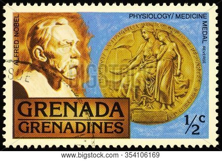 Moscow, Russia - February 25, 2020: Stamp Printed In Grenada, Shows Portrait Of Alfred Nobel (1833-1