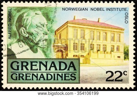 Moscow, Russia - February 26, 2020: Stamp Printed In Grenada, Shows Bas-relief Of Alfred Nobel (1833