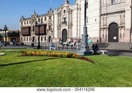 Lima / Peru - May 10 2016: A Catholic Cathedral In The Plaza De Armas With A Horse And Buggy And Sev