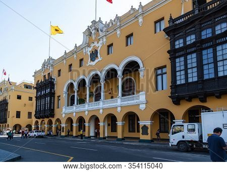 Lima / Peru - May 10 2016: The Front Of The Municipal Building In The Plaza Mayor De Armas With Peop