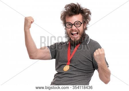 Happy winner. Crazy bearded Man with funny Haircut in eye Glasses celebrating success. Cheerful Guy with gold Medal, screaming and keeping mouth open, isolated on white background.