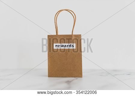 Customer Rewards And Fidelization Incentives, Shopping Bag With Price Tag With Rewards Written On It