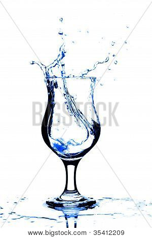 Pure Water Splashing Into Glass Isolated On White