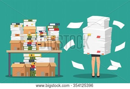 Businesswoman Holds Pile Of Office Papers And Documents. Documents And File Folders On Table. Routin