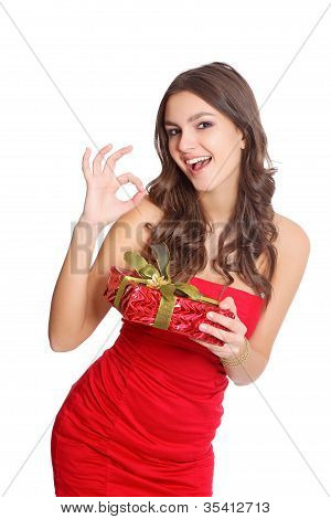 Happy red dressed girl with a gift