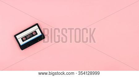 Retro Audio Cassette Flat Lay On Colorful Pink Background. Design In Minimal Retro 80-s Style. Music