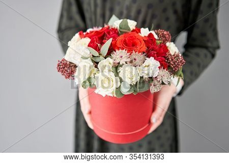 Red And White Floral Bunch In Round Box. European Floral Shop. Bouquet Of Beautiful Mixed Flowers In