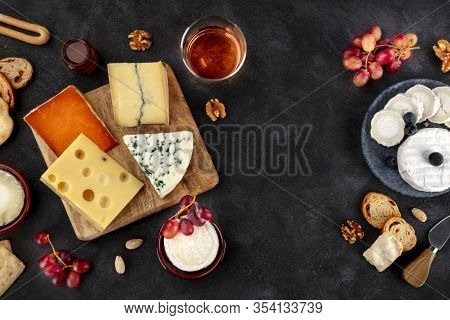 Cheese Variety. Goat Cheese, Brie, Blue Cheese Etc, Shot Above On A Dark Background With Copy Space