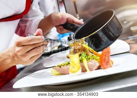 Chef Cooking, Chef Preparing Food In The Kitchen, Chef Decorating Dish, Closeup