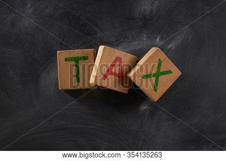 Tax Word On Black Board Background