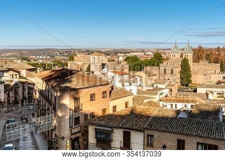 Toledo, Spain - December 6, 2019: Cityscape Of Toledo From The Ramparts With Puerta De La Bisagra, A
