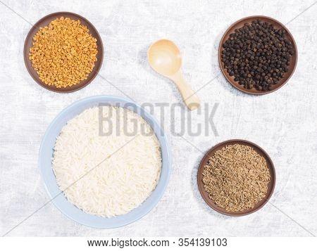 Indian Long Grain Basmati Rice In Blue Ceramic Bowl, Black Pepper, Cumin (jeera), Fenugreek On White
