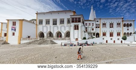 Sintra, Portugal - May 10, 2017: People in front of the National Palace of Sintra, the best-preserved medieval royal residence in Portugal. Since 1995  Sintra is listed as UNESCO World Heritage