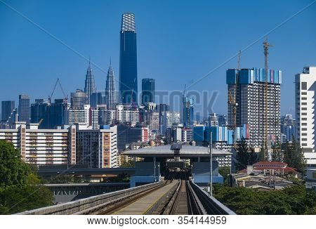 Kuala Lumpur City Skyline With Blue Sky