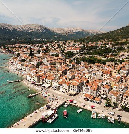 Aerial Panoramic View Of Baska Town, Popular Touristic Destination On Island Krk, Croatia, Europe.