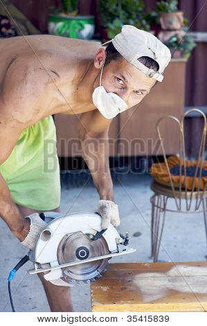 Man Working With Electrical Saw