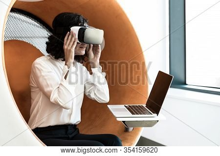 Business Woman Watching Virtual Presentation With Vr Goggles And Laptop. Woman In Office Clothes And