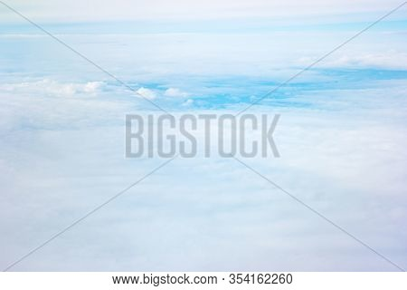 Fluffy White Clouds Against The Blue Sky.