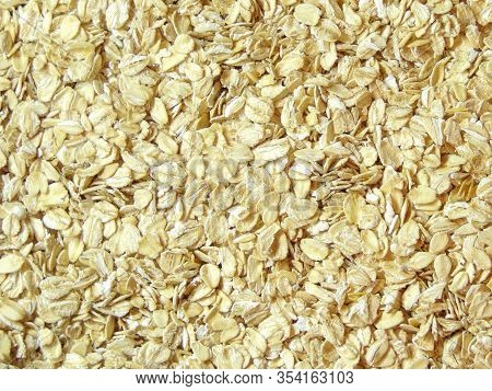 Oatmeal. Rolled Oats Background Texture. Background Useful Oatmeal For Tomorrow. Porridge For Athlet