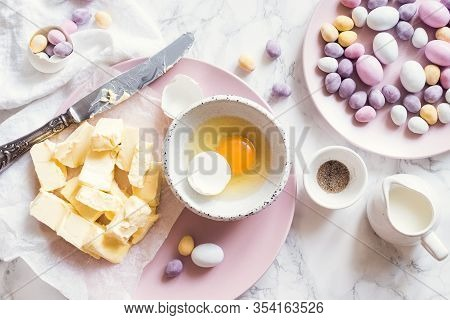 Process Of Preparation Easter Pastry Cake Or Cupcakes Decorated With Mini Chocolate Eggs Candy On Wh
