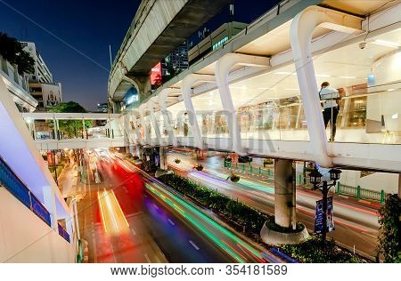 Bangkok, Thailand: Motion Blurs From Moving Cars Under Concrete Flyovers For Pedestrians, In Lights