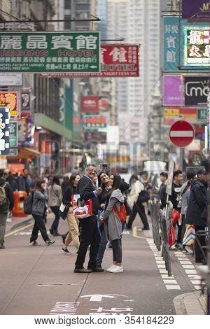 Hongkong China - March15,2019 : Middle East Tourist Family Taking A Photo At Hongkong Shopping Area,