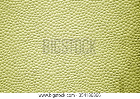 Bubbled Metal Sheet Texture In Yellow Tone. Abstract Background And Texture For Design.
