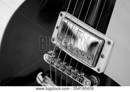 Black Electric Guitar Silver Humbucker Pickup And Bridge