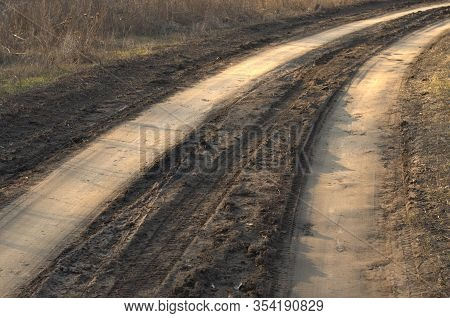Bad Muddy Countriside Road In Spring. Closeup Of The Dirty Country Road After The Snow Melts Or Rain