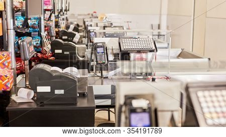 Row of cash registers as scanner cash registers in retail or supermarket