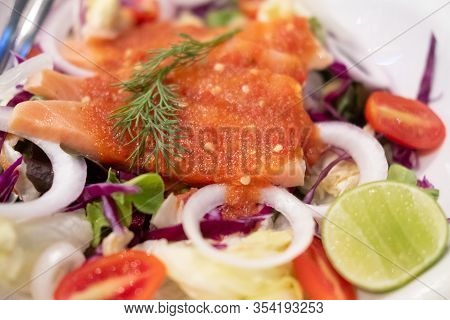 Salmon Sashimi With Spicy Hot Sauce. Japan Salmon Sashimi And Thai Herb In Japanese Restaurant.