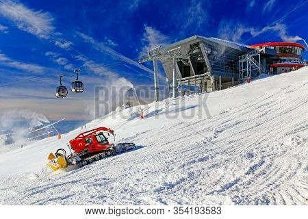 Demanovska Dolina, Slovakia - January 13: Modern Cableway And Groomer On The Hill Chopok In Ski Reso