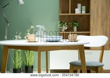 Modern Kitchen Interior In A Store In A Shopping Center. Kitchen Dining Table With Chairs. Cozy Deco