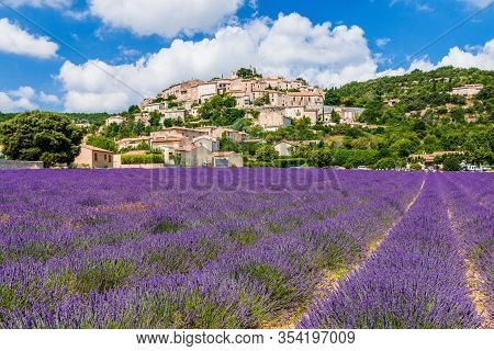 Simiane La Rotonde, France. Hilltop Village In Provence With Lavender Fields.
