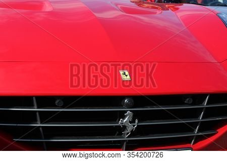 London,  Uk, May 13, 2019 - Closeup Of Sign On Red Parked Fast Modern Italian Car On The Street
