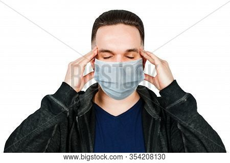 Sick Guy Looking At The Camera With A Surprised Medical Mask. Virus Protection During An Influenza E
