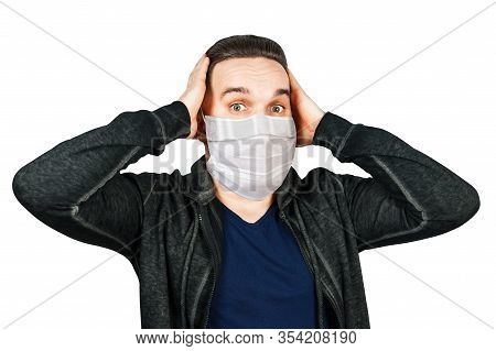 Sick Young Man With A Surprised Look In A Medical Mask. Virus Protection During An Influenza Epidemi